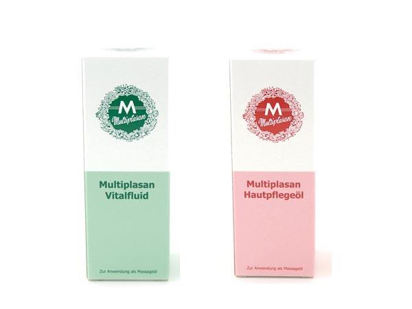 Zwei Flaschen mit unseren Ölemischungen Vitalfluid und Hautpflegeöl